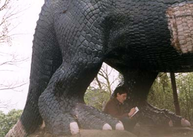 Brian Selznick drawing undeneath an Iguanodon